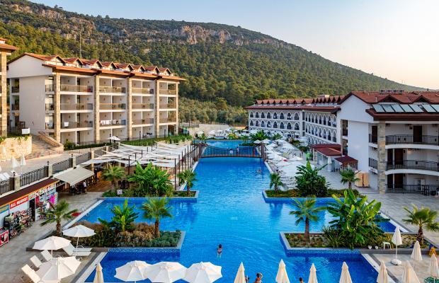 фото отеля Ramada Resort Akbuk изображение №1